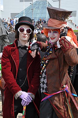 Willy Wonka (from Roald Dahl's Charlie and the Chocolate Factory), and the Mad Hatter (from Lewis Carroll's Alice's Adventures in Wonderland) MCM 2013 - Willy Wonka & Mad Hatter (8978291669).jpg
