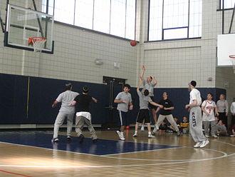 Maimonides School - A teacher takes a shot in the 2006 seniors vs. faculty basketball game.
