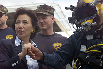 Makiko Tanaka - Makiko Tanaka (left) visits with the United States Navy dive team engaged in the salvage and recovery operation of Ehime Maru off Oahu, Hawaii on September 9, 2001.