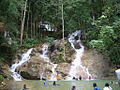 Malaysia - Local people bathing clothed in a waterfall - wetlook.jpg