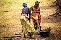 Mali women pounding cereals (38906236121).jpg