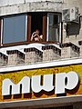 Man in Apartment Window - Tiraspol - Transnistria (36677770491).jpg