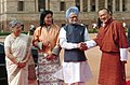 Manmohan Singh and his wife Smt. Gursharan Kaur with the Prime Minister of Bhutan, Mr. Lyonchen Jigmi Y. Thinley and his wife Mrs. Aum Rinsy Dem Thinley at a ceremonial reception at Rashtrapati Bhavan, in New Delhi.jpg
