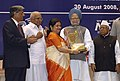 Manmohan Singh giving away the First National Award for Research & Development Efforts in Micro and Small Enterprises to Mrs. Jolly Guha Thakurta of West Bengal, at the presentation of National Awards-2007 for Micro.jpg