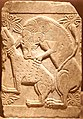 Marble closure slab with relief representation of deer being torn apart by lion. 10th-11th cent.jpg