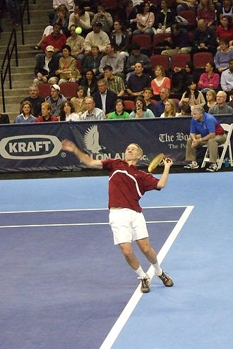 John McEnroe - John McEnroe serving during a Champions Cup Boston match, 2007