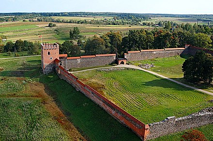Medininkai Castle, built in the first half of the 14th century. It is the largest enclosure type defensive castle in Lithuania and one of the primary landmarks of the Vilnius district. Medininku pilis is dangaus - www.aerialmedia.tv 02.jpg