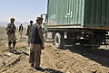 Members of the Afghan Border Police direct the placement of a container at a new checkpoint overlooking a mountain pass near the Afghanistan-Pakistan border in the Spin Boldak district of Kandahar province 130325-A-MX357-225.jpg