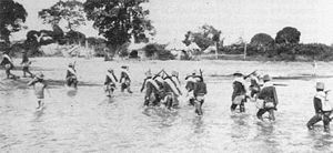 Battle of Pulang Lupa - Men of the 29th volunteer infantry wading ashore on Marinduque April 25, 1900