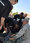 Miami Heat look at weapons of the 96th Ground Combat Training Squadron.jpg