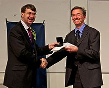 Mike Irwin receiving the Herschel Medal from Roger Davies in 2012