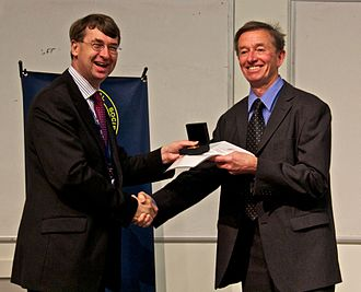 Mike Irwin - Mike Irwin receiving the Herschel Medal from Roger Davies  in 2012