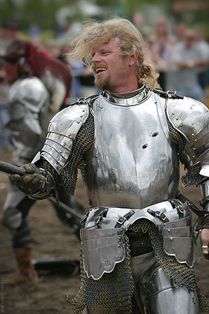 A modern day actor in medieval knight armor pa...