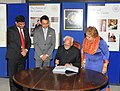 Mohd. Hamid Ansari signing the visitor's book during his visit to new building of the Oxford Centre for Islamic Studies, in London. Smt. Salma Ansari and the Minister of State for Human Resource Development.jpg
