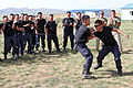 Mongolian General Police officers take part in a mechanical advantage control holds competition during Non-Lethal Weapons Executive Seminar (NOLES) 13 at the Five Hills Training Area in Mongolia Aug. 19, 2013 130819-M-DR618-022.jpg