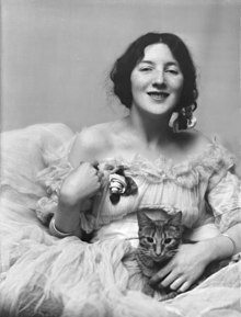 Munson, Audrey, Miss, with Buzzer the cat, portrait photograph.jpg