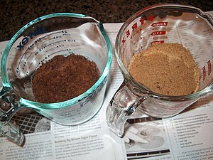 A measuring cup containing muscovado (left); o...
