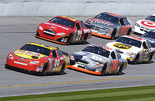 Cars drafting during a practice session at Daytona International Speedway
