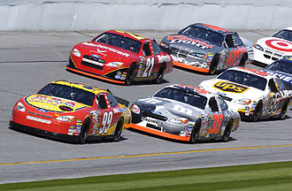 Stock car racing - NASCAR vehicles practicing at Daytona International Speedway in 2004