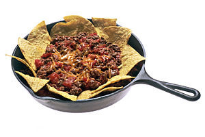 beef, beans, and cheese on a bed of tortilla chips