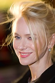 A headshot of a blonde woman looking off to the left