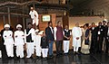 Narendra Modi in a Group photograph, at Dandi Kutir, in Mahatma Temple premises, Gandhinagar on January 08, 2015. The Chief Minister of Gujarat, Smt. Anandiben Patel and other dignitaries are also seen.jpg