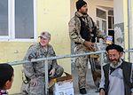 National Guardsmen distribute school supplies DVIDS342631.jpg