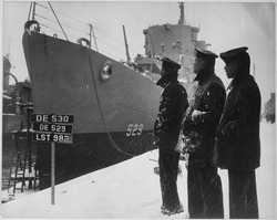 Negro sailors of the USS MASON commissioned at Boston Navy Yard 20 March 1944 proudly look over their ship which is... - NARA - 520644
