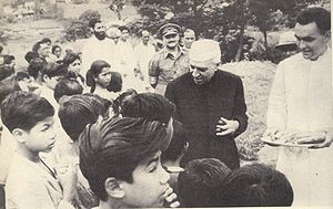 Children's rights movement - Nehru  distributes sweets to children on Children's Day in India.