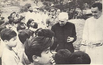 Children's rights movement - Nehru  distributes sweets to children on Children's Day in India.