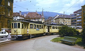 Trams in Neuchâtel - A route 5 tram set composed of 1902-built cars leaving the former Place Pury turning loop, in 1979. The trams of this type were in service for nearly 80 years.