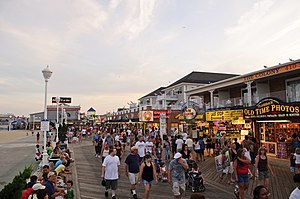 Boardwalk - The boardwalk in Ocean City, Maryland, a wooden pathway adjacent to the beach that is lined with businesses, typical of boardwalks along the East Coast of the United States.