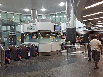 Fares and ticketing on the Mass Rapid Transit (Singapore) - Orchard MRT concourse level with the faregates.