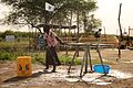Oxfam is helping to purify 1m litres of water a day (12451507093).jpg