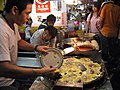 Oyster Omelette making by Prince Roy in Shilin Night Market.jpg