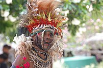 A Papua New Guinean wearing traditional garb. ...