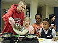 Parents and their kids cook healthy and tasty meals 150321-A-ZT122-171.jpg