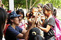 Participating in a community service event 120514-N-XG305-757.jpg