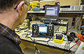 Pat McCarthy, a precision measurement equipment laboratory lead electronics technician with the 92nd Maintenance Squadron, calibrates a device used to check engine vibration on KC-135 Stratotanker aircraft 131105-F-JF989-011.jpg
