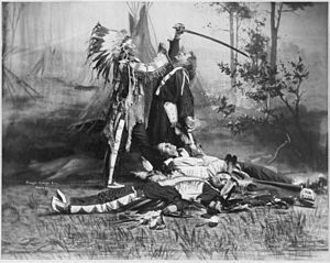 Death of Custer - A dramatic portrayal of Sitting Bull stabbing Custer, with dead Native Americans lying on ground, in scene by Pawnee Bill's Wild West Show performers. c.1905
