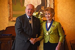 Kerry Sanderson - Sanderson being invested as a Companion of the Order of Australia (AC) by Peter Cosgrove, the Governor-General of Australia.