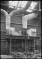 Petone Railway Workshops. Interior view with new heating apparatus, 1929. ATLIB 290068.png