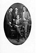 Photographic postcard of four IWW members, c. 1920s-1930s.jpg