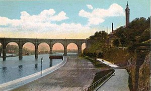 Highbridge Park - Photo-mechanical print of the Harlem River Speedway in the early 20th century showing river access from Highbridge Park