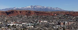 A photo of St. George with the Pine Valley Mountains in the background