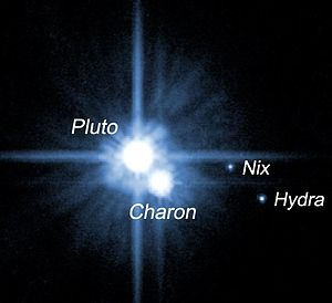 Moons of Pluto - The Hubble discovery image of Nix and Hydra