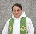 Portrait of Ken Howard, Episcopal Priest, with cross and star of david stoll.jpg