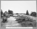 Queensland State Archives 3251 Placing hand packed rubble behind retaining walls south approach 2 March 1936.png