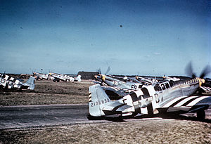 "RAF Bottisham - P-51 Mustangs, including (E9-S, serial number 42-106707) nicknamed ""Sleepytime Gal"", (B7-E, serial number 42-106839) nicknamed ""Bald Eagle III"" and (E9-K) nicknamed ""Vi"" opf the 361st Fighter Group line up for take off on D-Day at Bottisham."