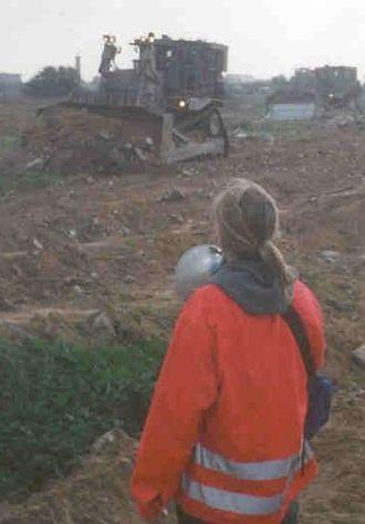 Rachel Corrie - Rachel Corrie stands before Israeli IDF Caterpillar D9 bulldozers